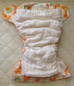 You can see how the cotton inside goes right up to the edges of the backing, which made the diaper leak proof!